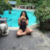 Camila Mendes Enjoying Pizza by the Poolside - March 21, 2017